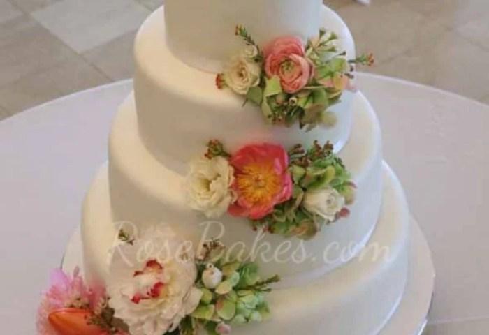 White Wedding Cake With Cascading Fresh Flowers Rose Bakes