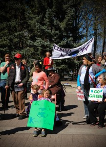 Children holding save the earth signs. April 26-2015 yyc