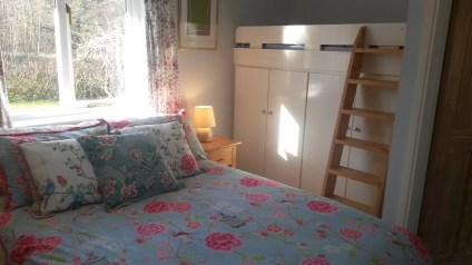 Bedroom showing integrated child's bed.