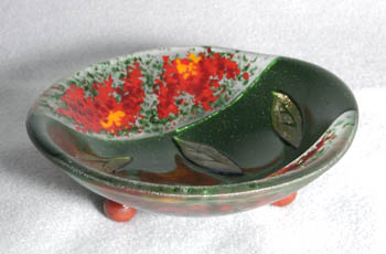 "FLOWER FALLS 6"" footed bowl with iridized leaves and frit flowers."