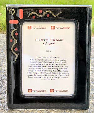 Red glass and brass accent this frame mounted on an 8x10 acrylic bent frame.