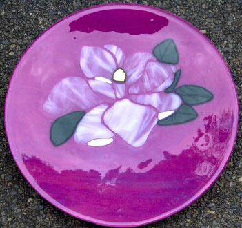 "MAGNOLIA WHISPERS Deep pink 14"" platter with light lavender streaks and aventurine green leaves. The magnolia is streaky white and clear. The stamen is dichroic gold and green."