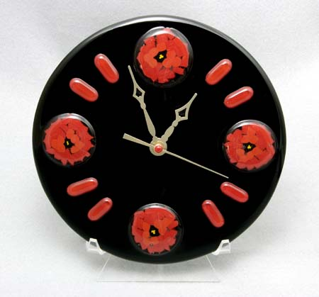 "POPPY CLOCK 8"" clock with pattern bar accents. Wall mounting hardware included."