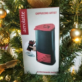 A box with an Aerolatte Cappuccino Design Artist set nestled in a Christmas Tree