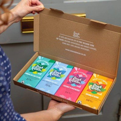 A Valentine's Gift idea: The seed and Bean subscription. a letterbox sized cardboard box open to show four brightly coloured bars of Seed and Bean Chocolate
