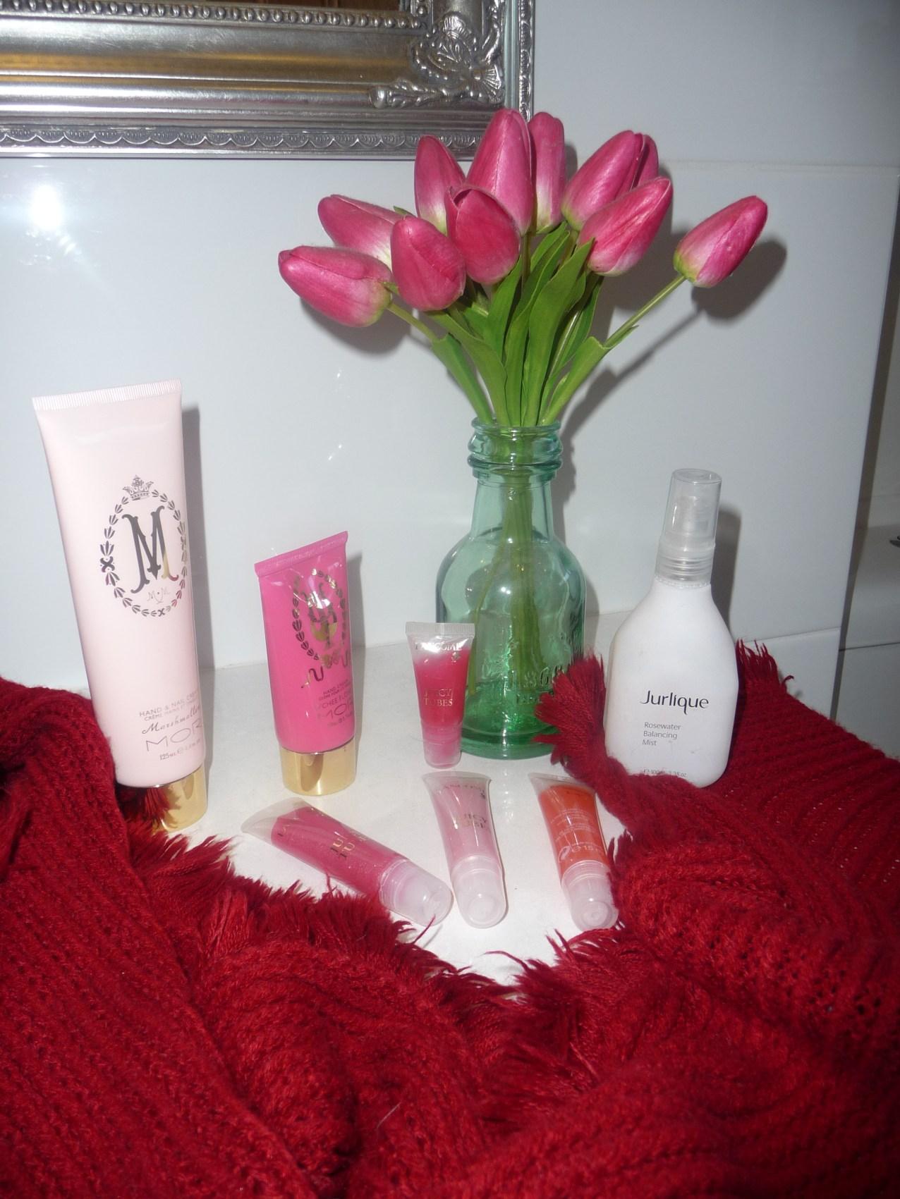 Travel essentials including red pashmina/scarf