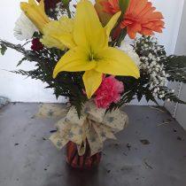 Perfect flower-filled vase by ROSE PETALS florist