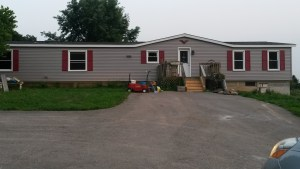 New siding and freshly painted shutters