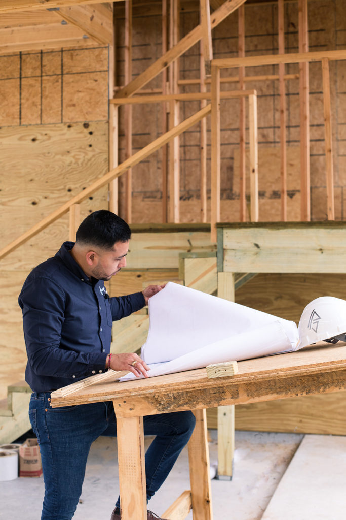 contractor looking through blueprints for home being built