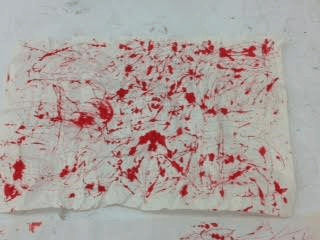 folded up lots times red ink abstract drawing