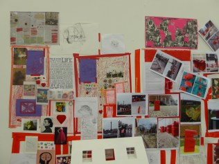 My studio wall currently with my photos from Firstsite and london taken of my red resin figure men.