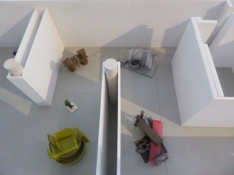 Mini sculptures structured in a construction like a house.