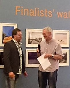 Martin Parr giving out a Prize to a photography competition finalist