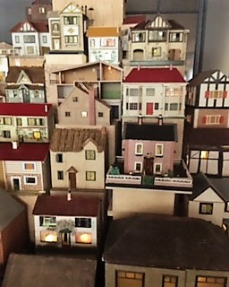 A section close up of some of the lit up dolls houses