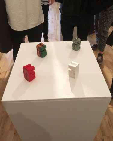 All four selected figures displayed together on a plinth