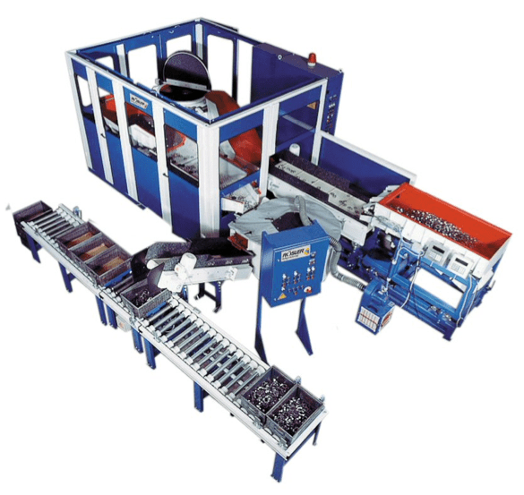 Roller conveyors on this Rosler FKS mass finishing system stage finished work pieces.