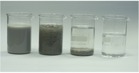 Mass finishing process water in different cleaning stages.