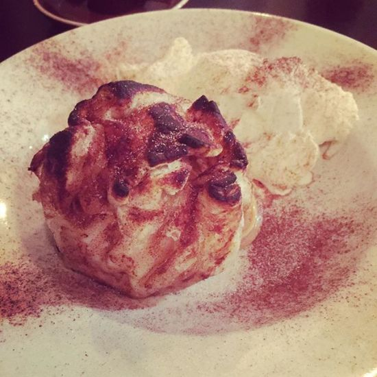 Baked apple bomb, stuffed w/ caramel wrapped in cinnamon puffed pastry w/ vanilla bean ice cream