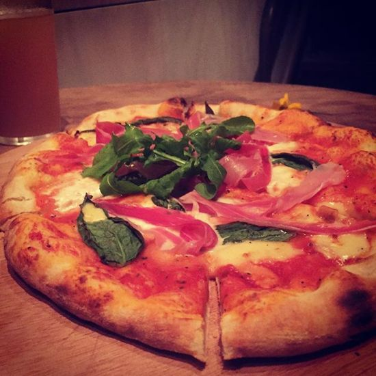 Prosciutto pizza and a ginger beer