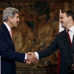US Secretary of State John Kerry (L) shakes hands with Polish Foreign Minister Radoslaw Sikorski