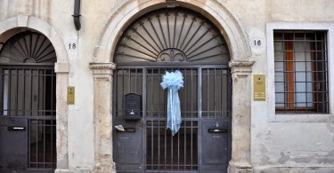 A child is born - a blue bow decorates the entrance door of a house in Vicenza signaling that a baby boy has been borne into the home