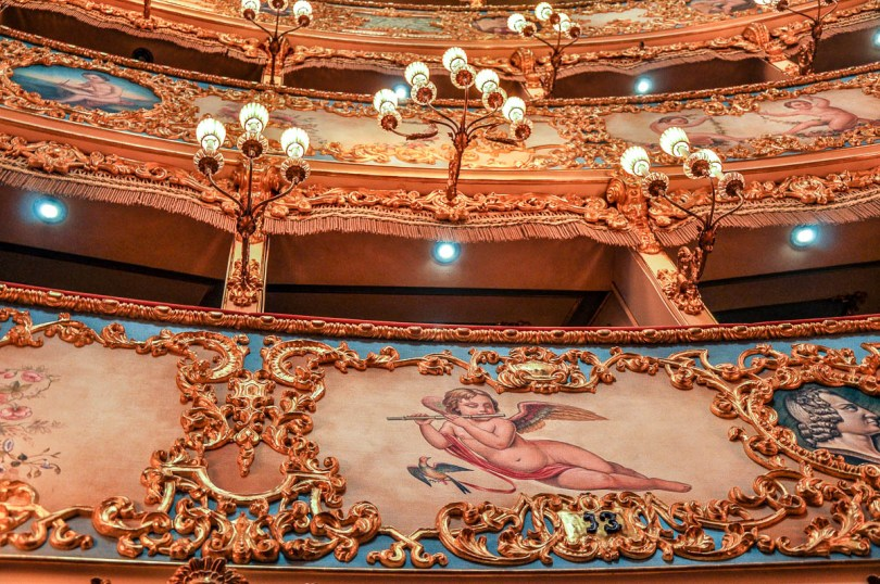 Close-up of the lights and the frescoes of the boxes - La Fenice Opera House in Venice, Italy - www.rossiwrites.com