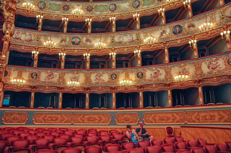 Tourists listening to their audio guides - La Fenice Opera House in Venice, Italy - rossiwrites.com