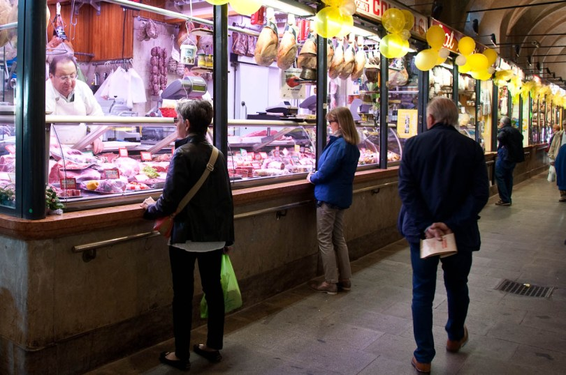 Shopping at the butcher's on the ground floor of Palazzo della Ragione, Piazza delle Erbe, Padua, Italy - www.rossiwrites.com