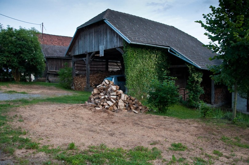 Kozolec - Traditional hayrack barn used to store wood and to park a car, Primostek, Slovenia - www.rossiwrites.com