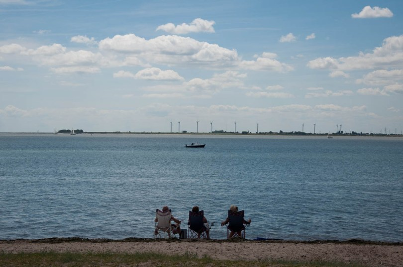 Sitting on foldable chairs at the beach, Mersea Island, Essex, England - www.rossiwrites.com
