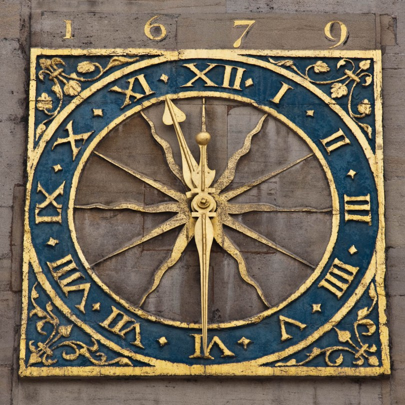 The Cambridge University Clock, set above the West door of Great St Mary's, Cambridge, England - www.rossiwrites.com