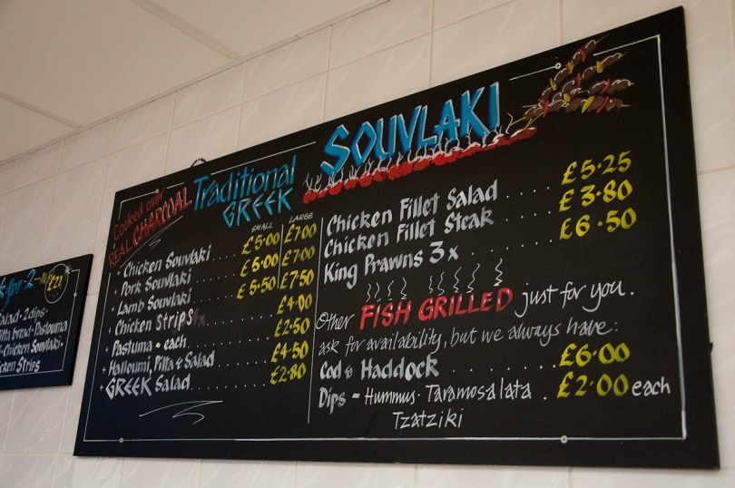 The traditional Cypriot menu on the wall, The Master Fryer Fish and Chips Shop, St. Albans, England - www.rossiwrites.com