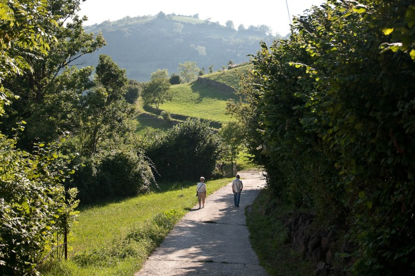 A couple walking down the road in Bolca, Province of Verona, Italy - www.rossiwrites.com