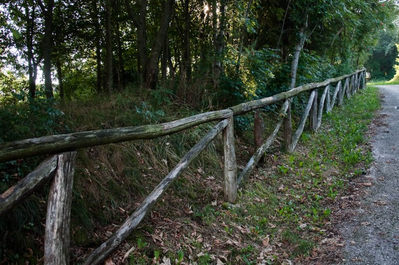 The wooden railings following part of the red trail in Bolca, Province of Verona, Italy - www.rossiwrites.com