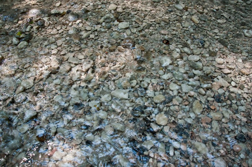 Clear water over pebbles, Parco delle Cascate, Province of Verona, Italy - www.rossiwrites.com