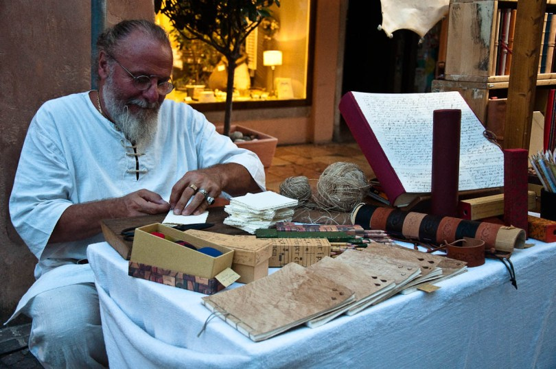 The bookbinder at work, Mediaevil Fair, Castelfranco Veneto, Italy - www.rossiwrites.com