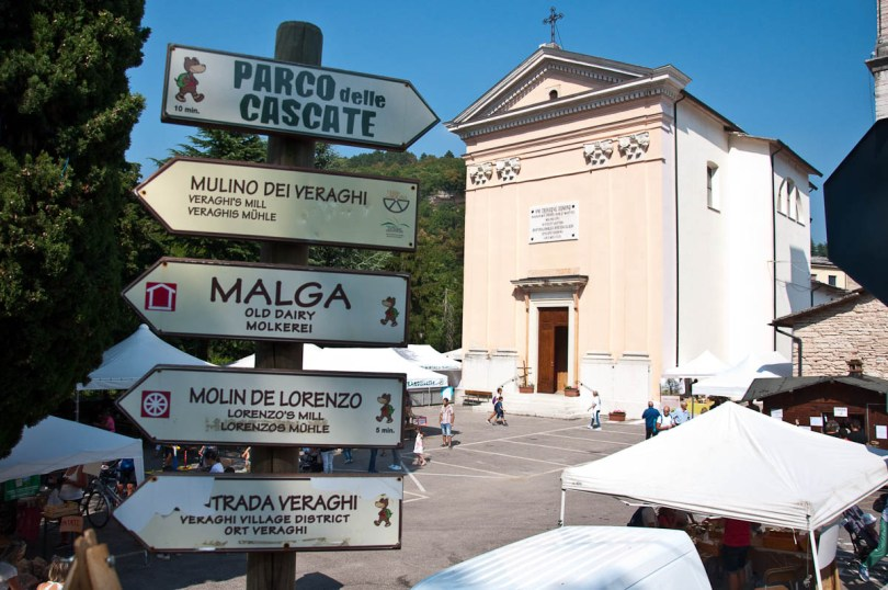 The church and the signs pointing to the mills, Molina, Province of Verona, Italy - www.rossiwrites.com
