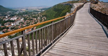 The wooden bridge and the town of Provadia, Ovech Fortress, Provadia, Bulgaria - www.rossiwrites.com