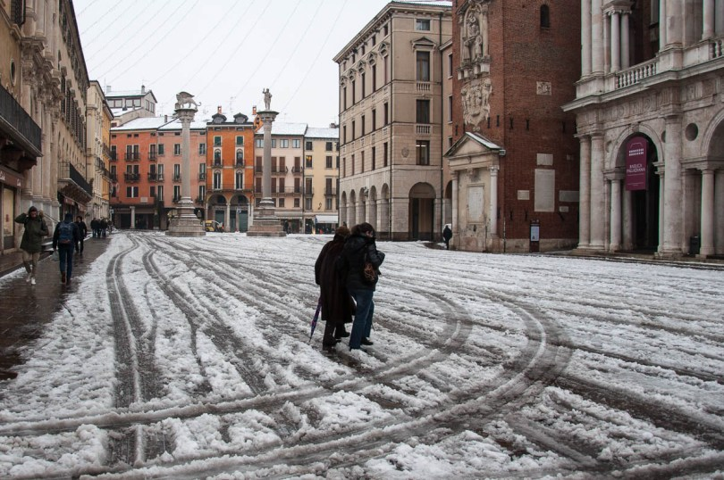 Piazza dei Signori with people walking in the snow - Vicenza, Veneto, Italy - www.rossiwrites.com