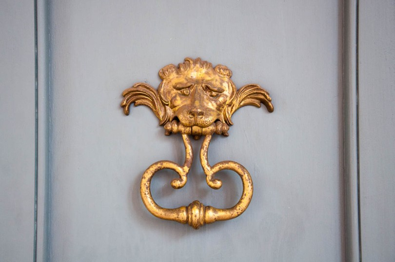 The lion-head door knocker at Teatro Alighieri - Ravenna, Italy - www.rossiwrites.com