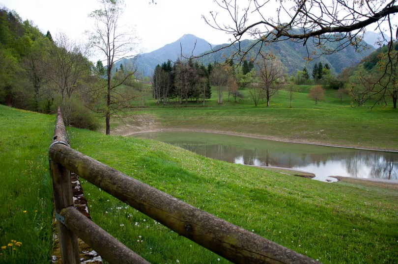 The wooden handrails with the Pre-Alps - Laghi, Veneto, Italy - www.rossiwrites.com