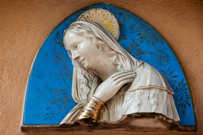 A majolica Virgin Mary adorning a house wall - Rovereto, Trentino, Italy - www.rossiwrites.com
