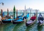 Gondolas with the island of San Giorgio Maggiore in the background - Venice, Italy - www.rossiwrites.com