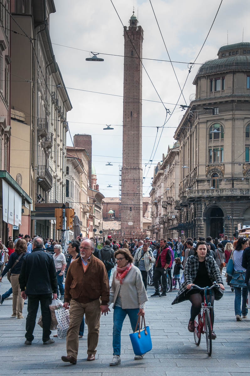 Bologna's busy streets with the Tower of Asinelli - Bologna, Emilia-Romagna, Italy - www.rossiwrites.com