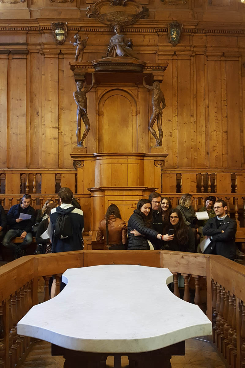 Tourists taking selfies in the Anathomical Theatre - University of Bologna - Bologna, Emilia-Romagna, Italy - www.rossiwrites.com