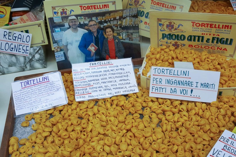 Window display with torta di riso and other local specialties - Bologna, Emilia-Romagna, Italy - www.rossiwrites.com