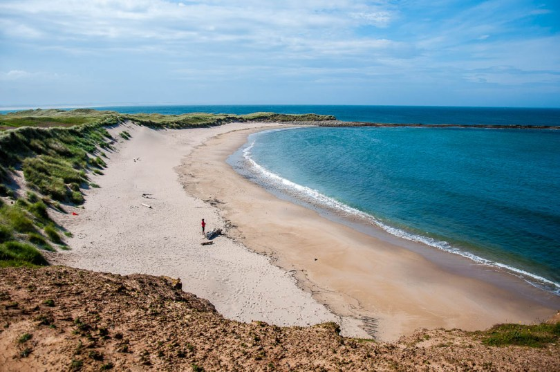 A small sandy beach - Holy Island of Lindisfarne, Northumberland, England - www.rossiwrites.com