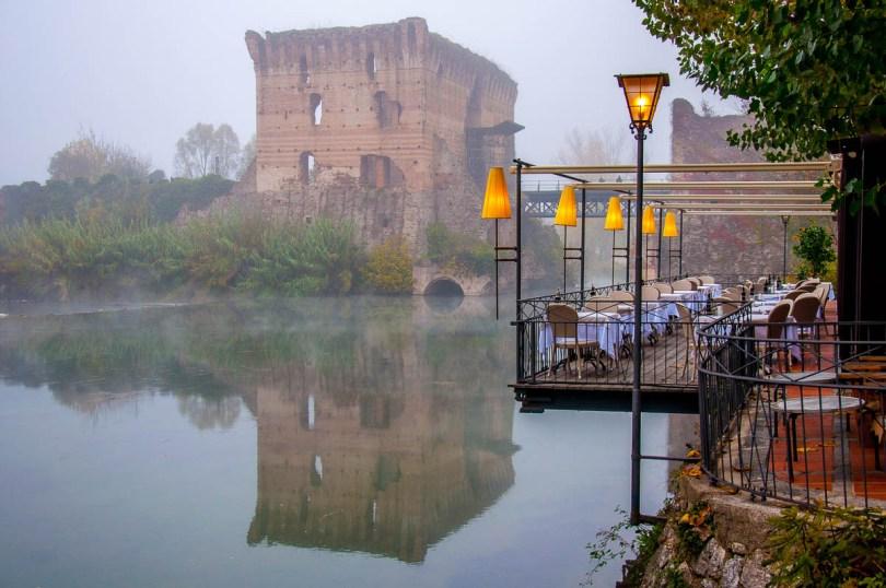 The 14th century Visconti bridge in the fog - Borghetto, Valeggio sul Mincio, Veneto, Italy - www.rossiwrites.com