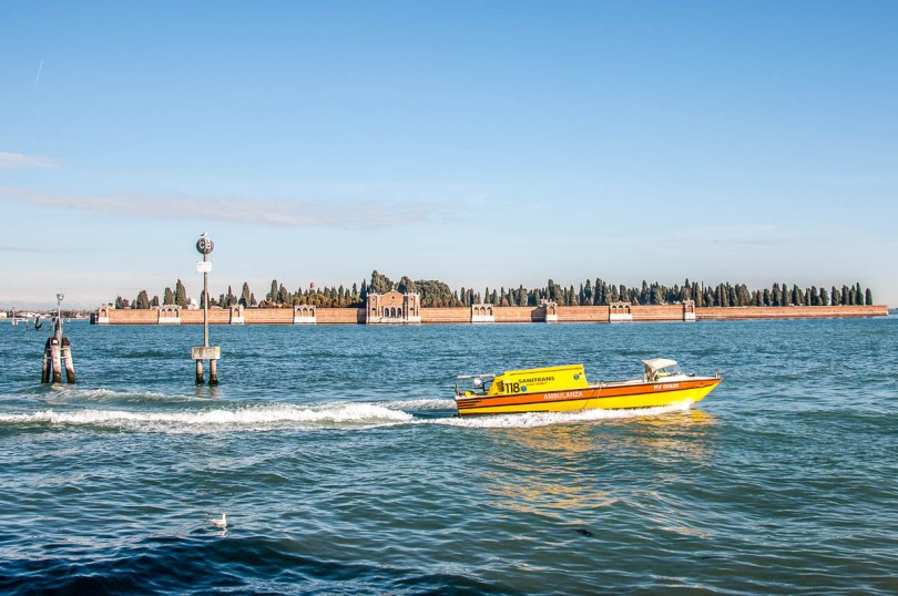 A Venetian ambulance boat with Isola di San Michele at the back - Venice, Veneto, Italy - www.rossiwrites.com