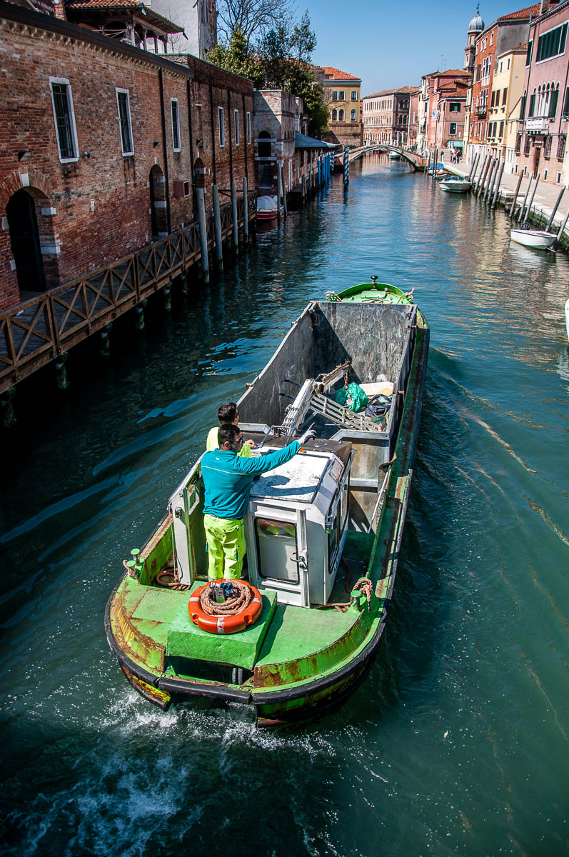 A rubbish-collecting boat - Venice, Italy - www.rossiwrites.com